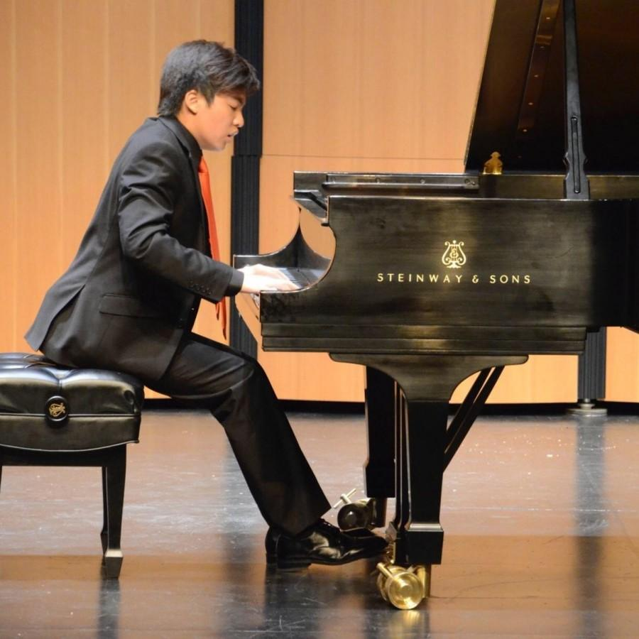 Eden+Chen+performs+one+of+his+long+practiced+songs+at+a+recent+competition.