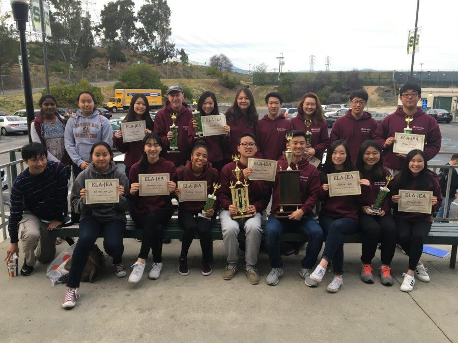 DBHS+students+from+Journalism+I+and+The+Bull%27s+Eye+staff+hold+up+their+awards+and+trophies+from+the+Eastern+L.A.+JEA+write-offs+on+March+4.