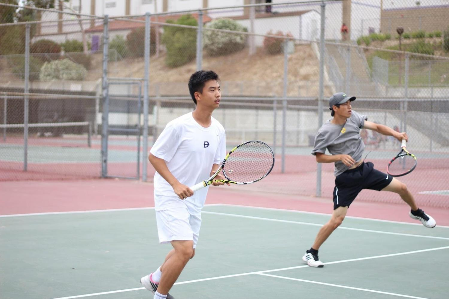 Freshman+Akilan+Arunachalam+and+doubles+team+of+sophomore+Victor+Chai+and+junior+Michael+Tran+%28from+left%29+on+the+court.