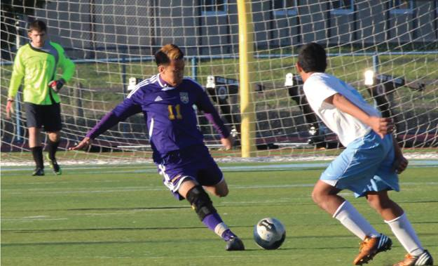 PROTECT FIELD POSITION- Senior forward Will Lee clears the ball out of DB's territory  to put the Brahmas in position to score.