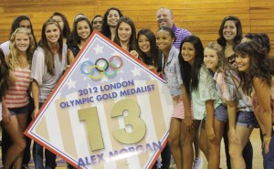 LUCKY NUMBER 13(Second to the left, front) - Alex Morgan proudly displays her diamond banner with the current girls soccer team and faculty members to celebrate her retired number.