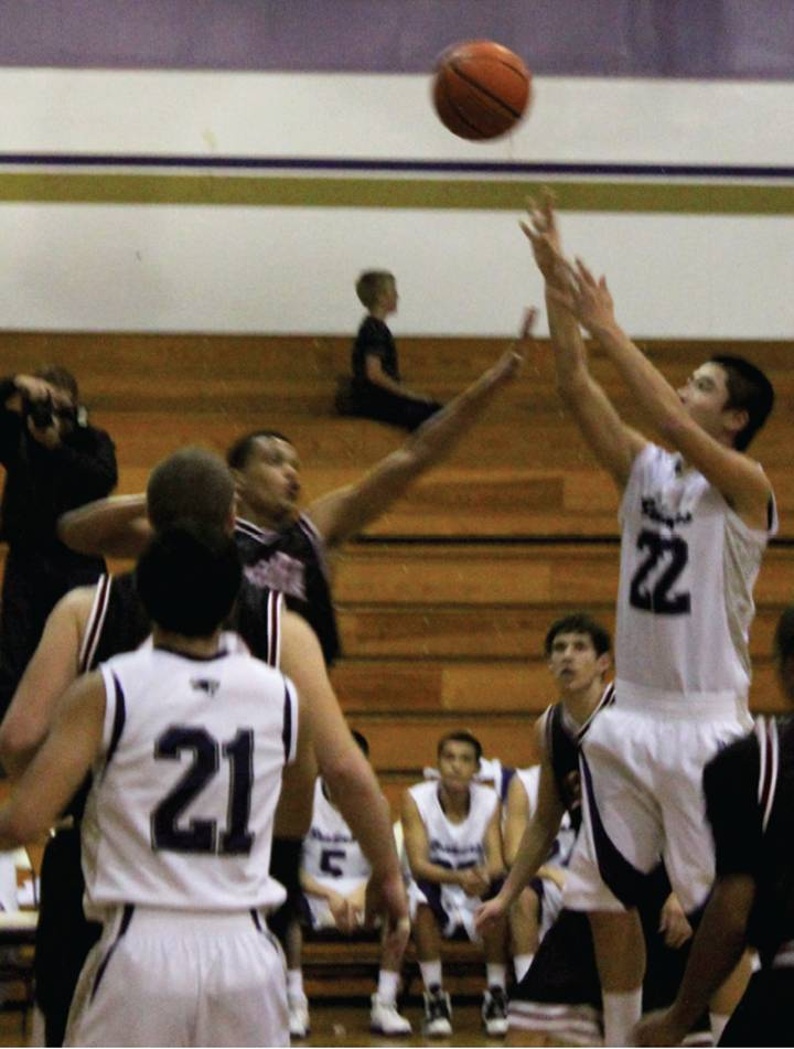 MAKING IT RAIN - Senior Sam Ting pulls up for a jumper to lead the Brahmas' comeback.
