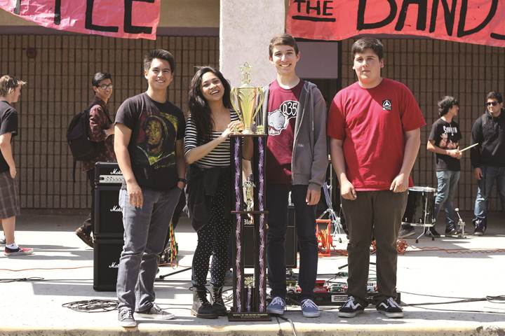 """ROCK ON - The four members of Tori and the Berbas proudly stand with the trophy they won after performing """"Ooh La La"""" at the upper quad during an intense week of Battle of the Bands, which was held during lunch."""