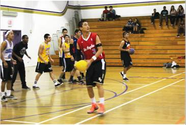 GET YOUR HEAD IN THE GAME - Senior Sam Ting prepares to hit opponents at the staff versus student dodgeball game.