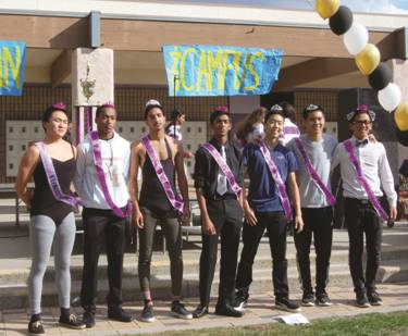 TEENAGERS IN TIARAS - After Sachin Malik was crowned Big Man on Campus, the seven DBHS seniors posed for the camera in their sashes and tiaras.