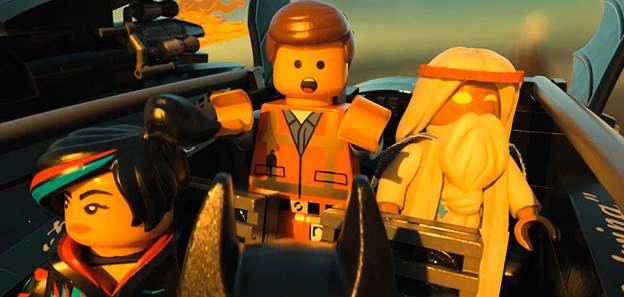 "BUILT FOR ACTION – Emmet Brickowaski, the ""Special,"" rides an aircraft with Master Builders WyldStyle and Vitruvius to fight Lord Business."