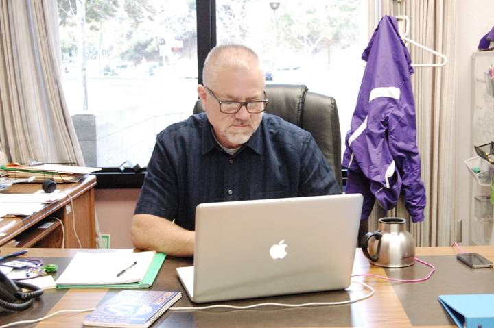 FRESH FACULTY - DBHS' new operations manager, Mefford, works at his office with plans of future renovation for the school.