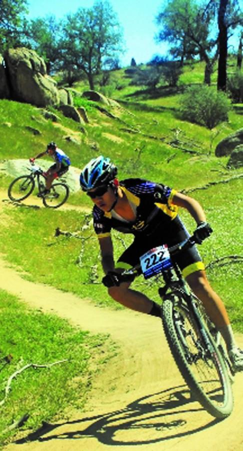 Ed Tseng, one of the members of last year's mountain bike team, pedals down a trail during a competition.