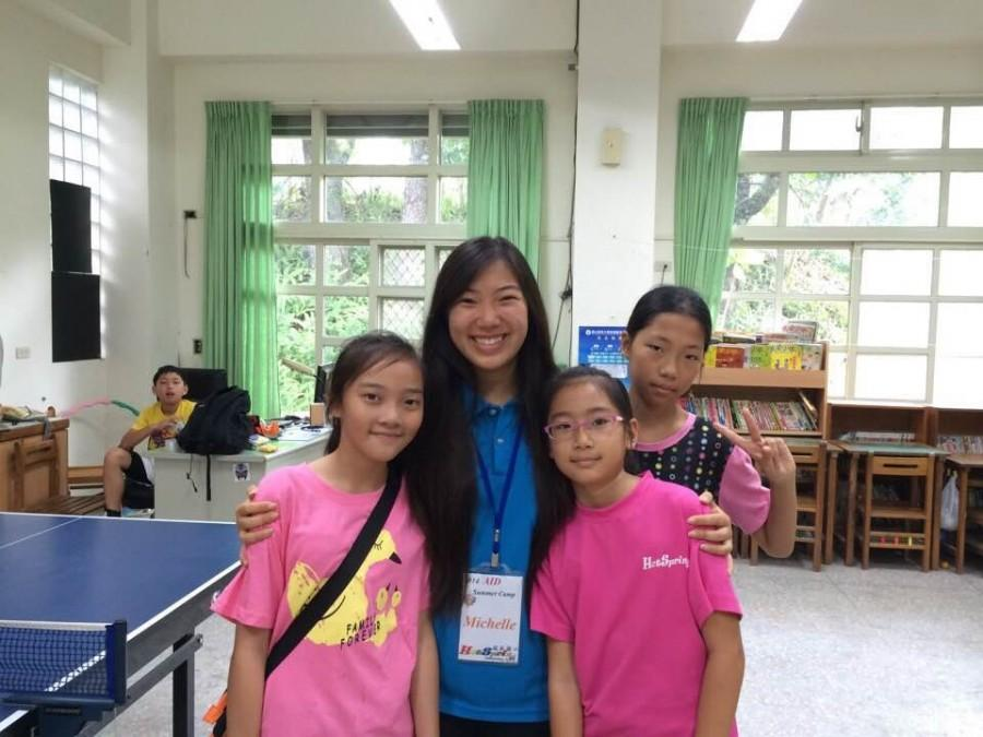 Participating+in+the+Aid+Summer+2014+program%2C+senior+Michelle+Lyu+taught+English+to+impoverished+children+in+Taiwan.+