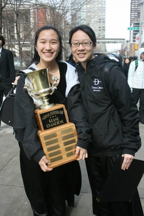 Above, students Bridget Pei (left) and Nicole Chen (right) hold the well-deserved trophy. (Photo Courtesy of DBHS Symphony)