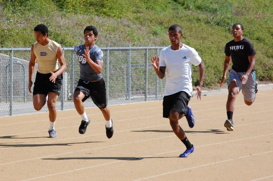 Senior Xavier Johnson sprints against his teammates.