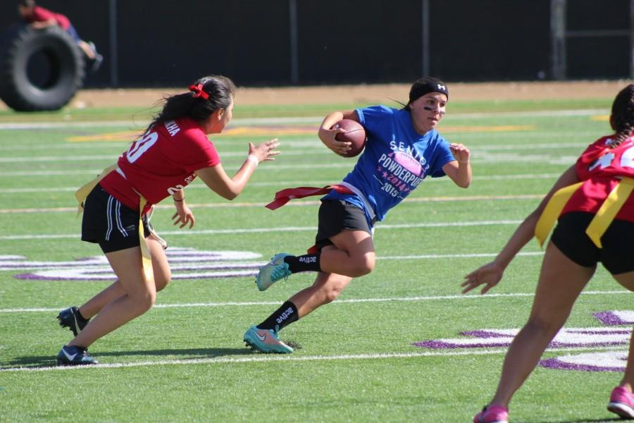 Senior Ariana Infante runs through defenders in an attempt to score.