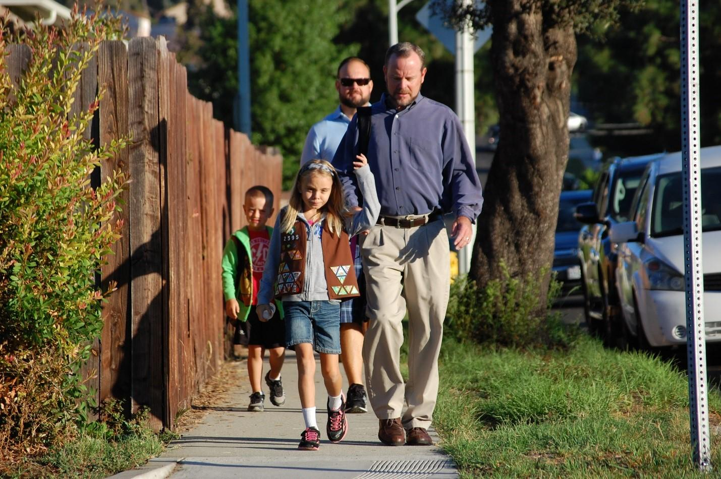 The trio of teachers meet up on a daily basis to walk their children to Evergreen.