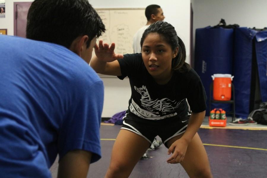 Sophomore+Rejie+Palingayan+prepares+to+pin+her+opponent+during+practice.