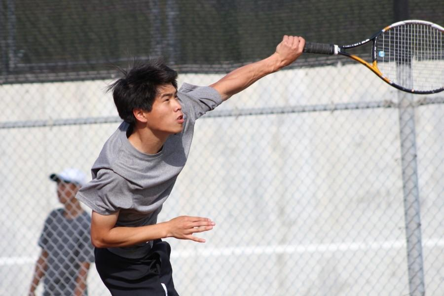 Sophomore+Michael+Tran+practices+in+a+preseason+game+under+new+coaches.