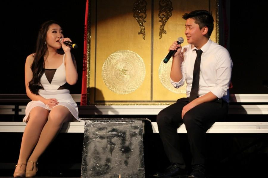 Nicholas Zhou and Crystal Ng sing