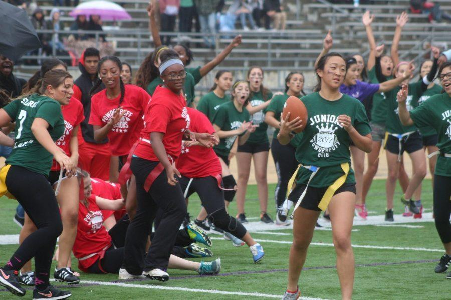 Junior Kayla Pak (right) scores a touchdown in the annual junior vs. senior Powderpuff game on April 8, a game which ended in a tie.