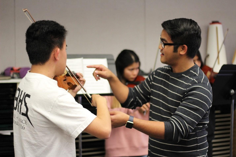 Student teacher Jason La Meda helps enhance DBHS students' musical skills.