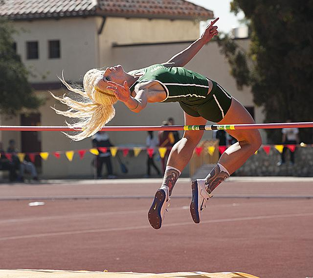 Jillian Schmidt clears a height in the high jump during the Rossi Relays at Claremont McKenna College in Claremont February 23, 2013.