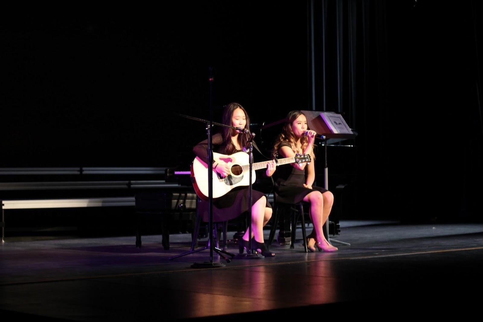 "Juniors Emily Tran and Pauline Yang sing ""Hallelujah"" as part of the fall concert."
