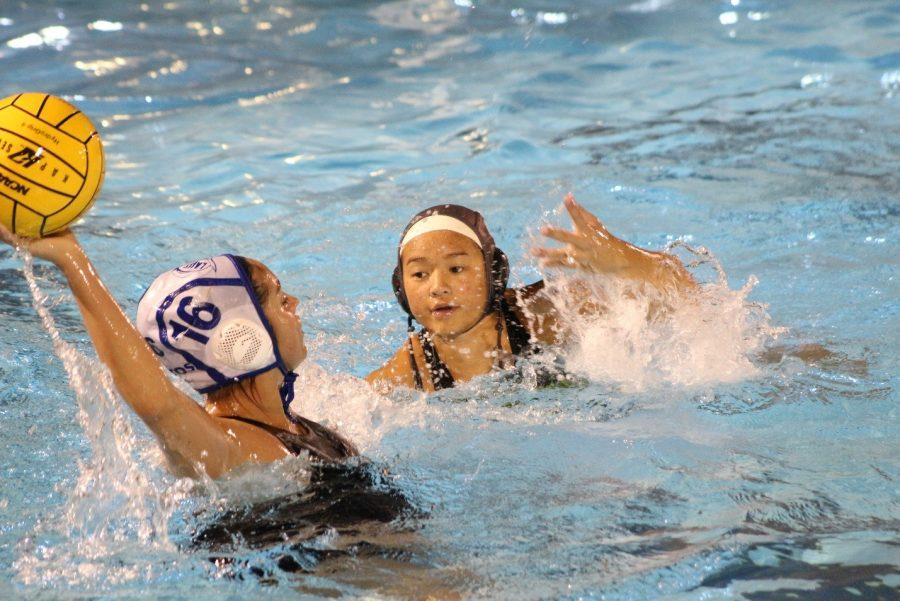 Junior Monique Yim attempts to grab the ball from her opponent in a scrimmage against  Alta Loma.