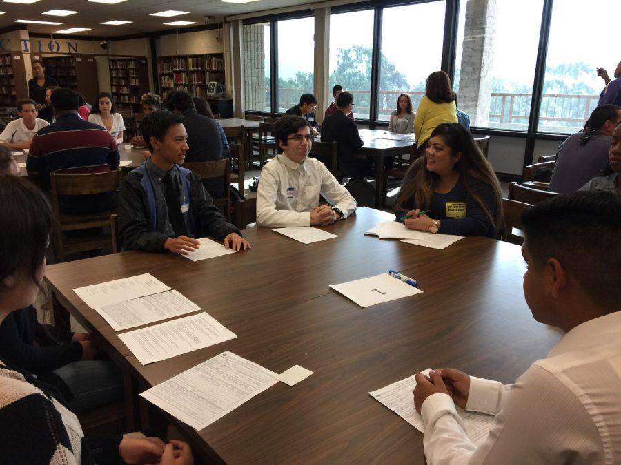 Students participate in mock interviews with Starbucks managers in the LINC.
