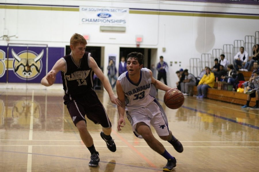 Senior Chris Chebat dribbles the ball down the court.