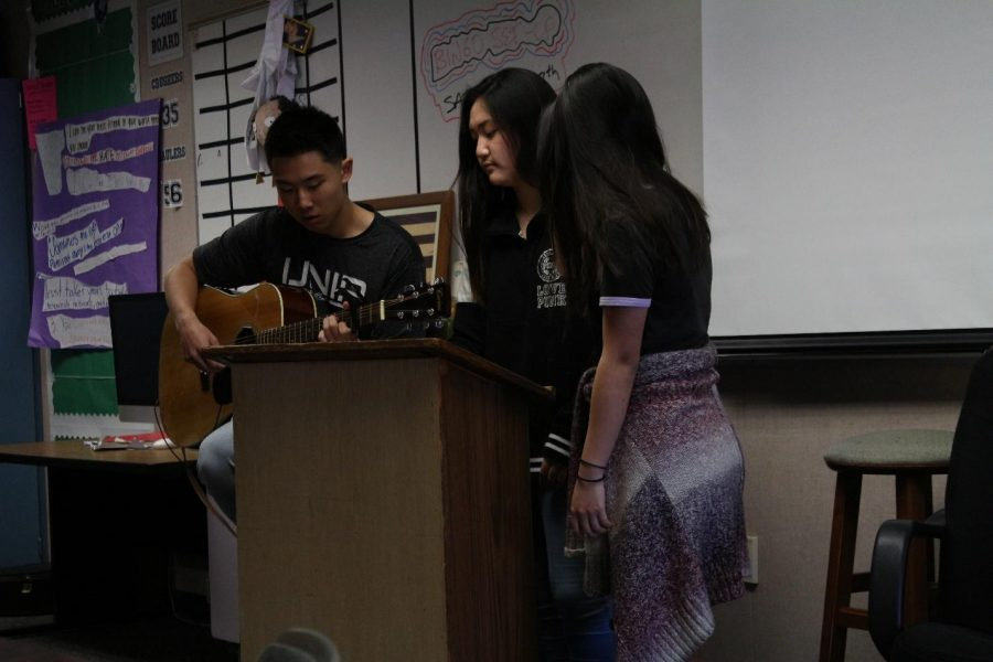 Aftershock's worship team sings in worship in front of the rest of the club members in Calero's room at lunch on Tuesday, when they hold their meetings.