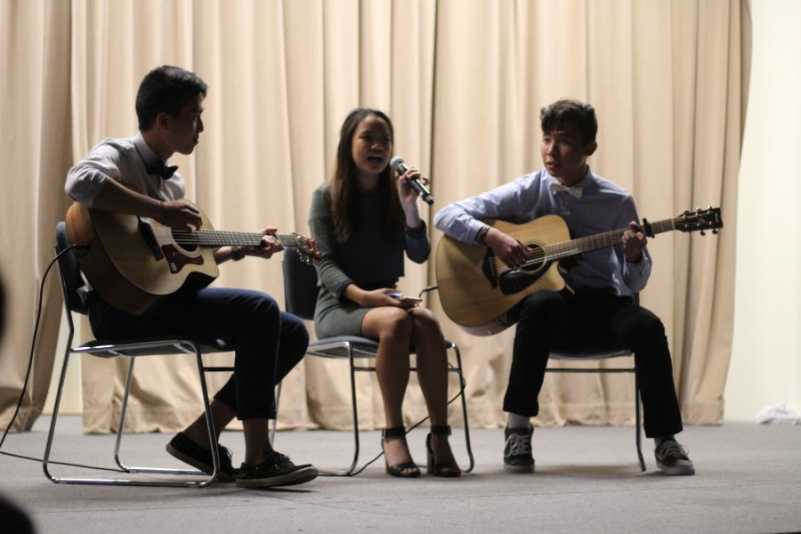 From left to right, seniors Michael Xu, Claire Medina and Aaron He perform
