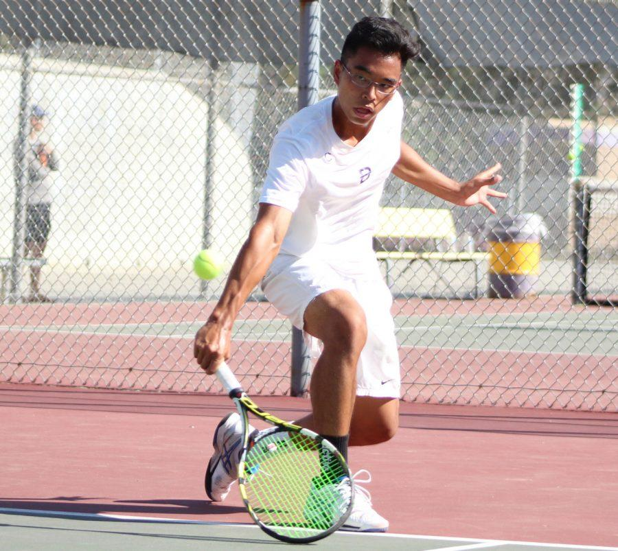 Senior Neil Tengbumroong slices the ball in a match against Glendora.