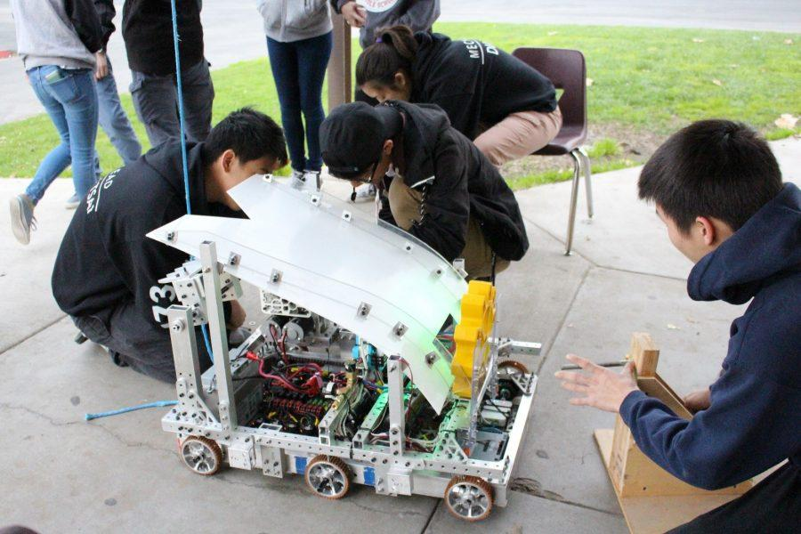 From+left+to+right%2C+junior+Nathan+Tsai+and+seniors+Casey+Chen+and+Brian+Song+work+on+their+robot+at+their+San+Diego+Regional+Competition.