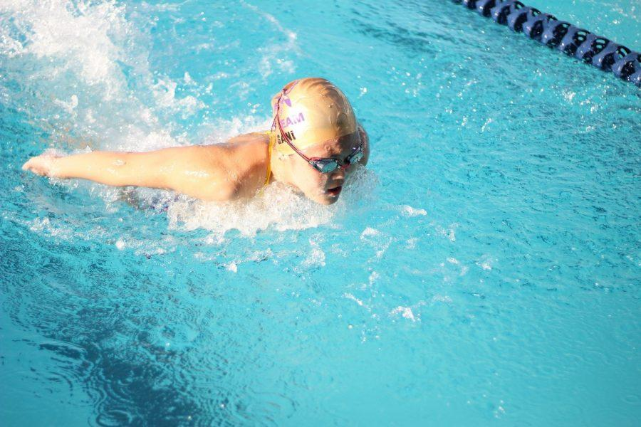 Senior Kathleen Gani competes in a butterfly event in a match against Walnut.