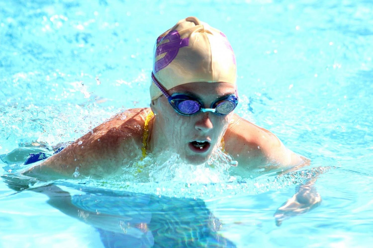 Senior Sophia Brown competes in a meet against South Hills. The boys and girls won 133-25 and 124-42 respectively.