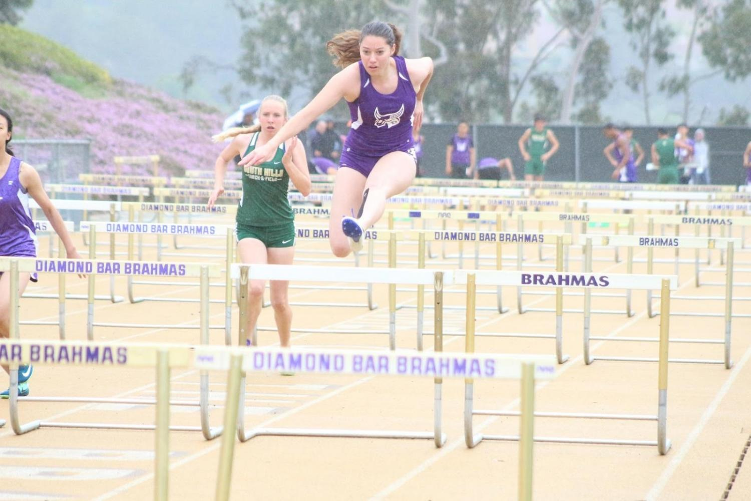 Junior+Ana+Figueroa+competes+in+hurdles+at+the+first+home+meet+of+the+season.