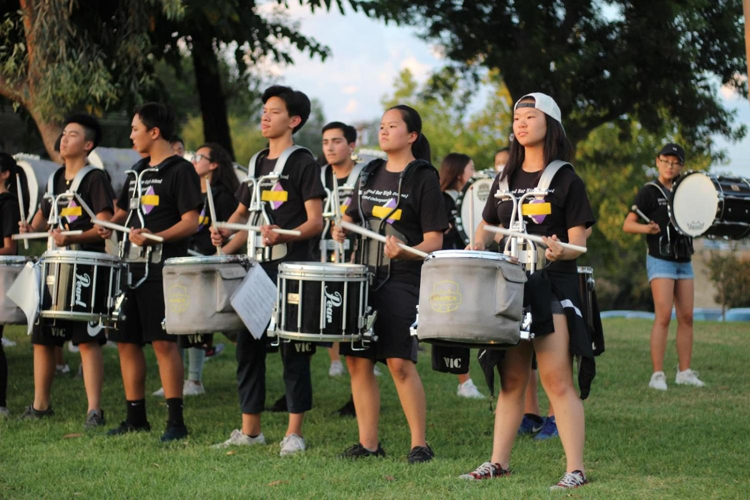 From left to right, percussion members Edison Chow, AJ Cembrano, Isaac Kau, Michelle Wu and Johannah Chung perform in front of the school gates to welcome students and parents to this year's Back to School Night on Aug. 30.