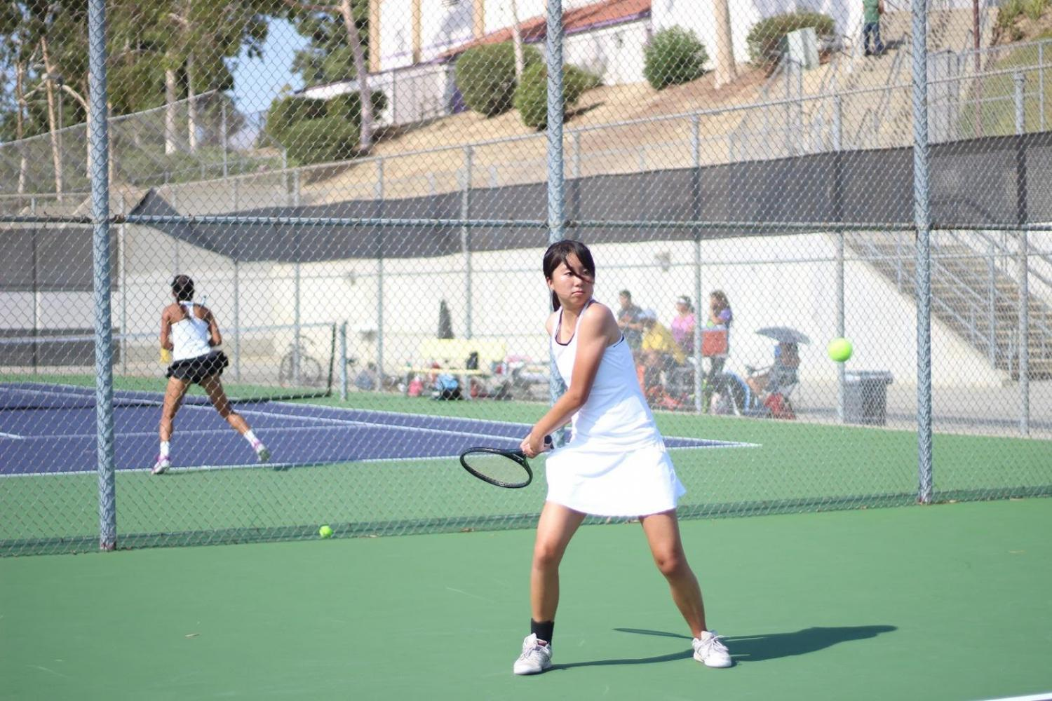 Senior Amy Xia rallies in DB's first match of the year against El Dorado.