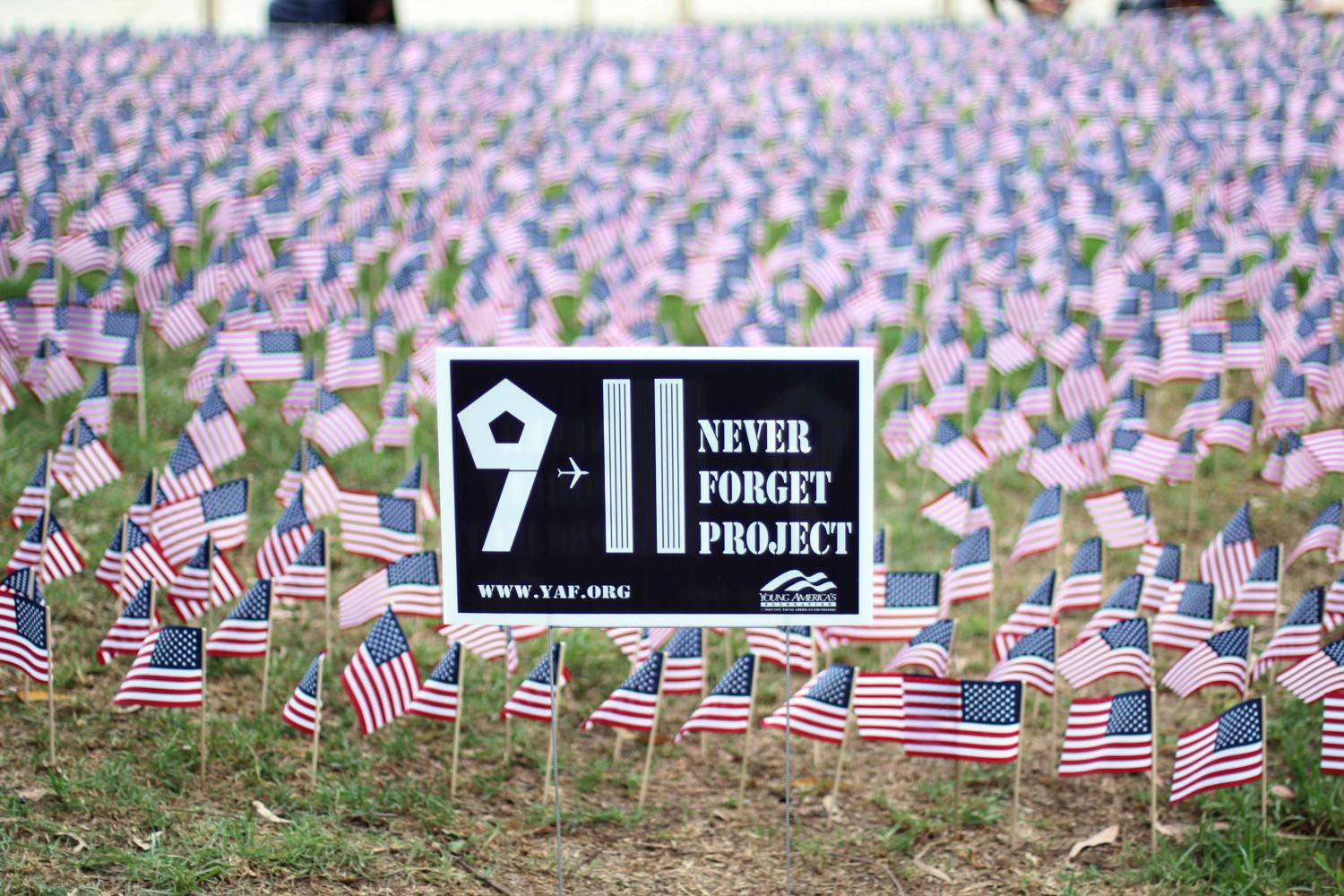 Seniors William Liang, Rhiston Yu, Jonathan Lewin and Hedric Pisigan displayed 2,997 flags (number of lives lost on 9/11) in the front of the school.