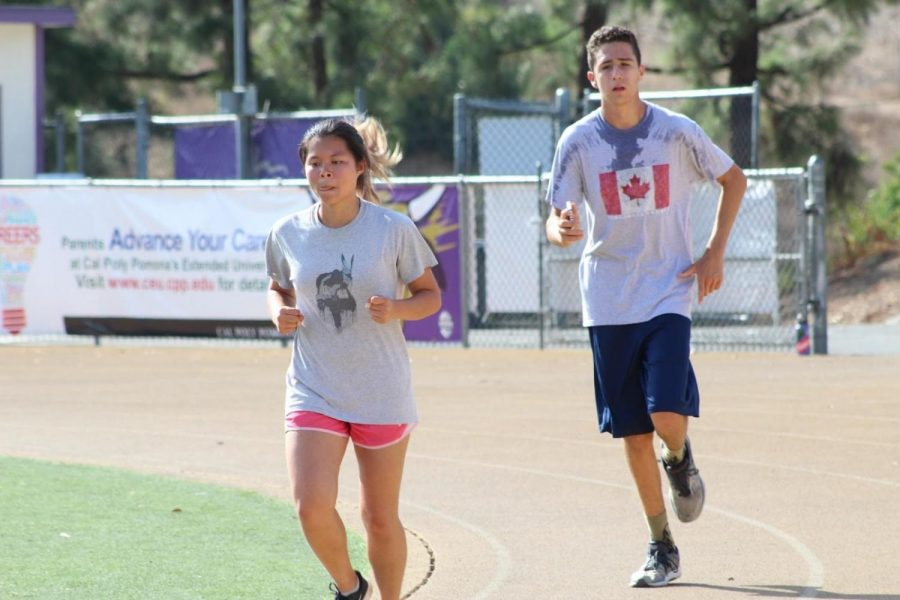 Senior Janet Wong and junior Garrett Miller practice to improve their times.