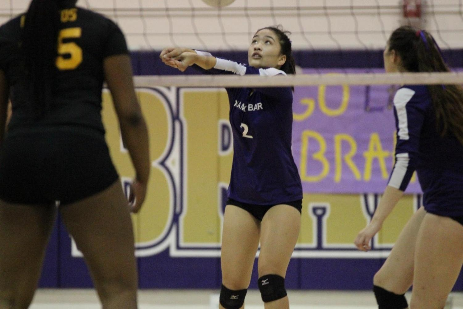 Senior Hannah Wangsa returns a volley against Cerritos on Nov. 2.
