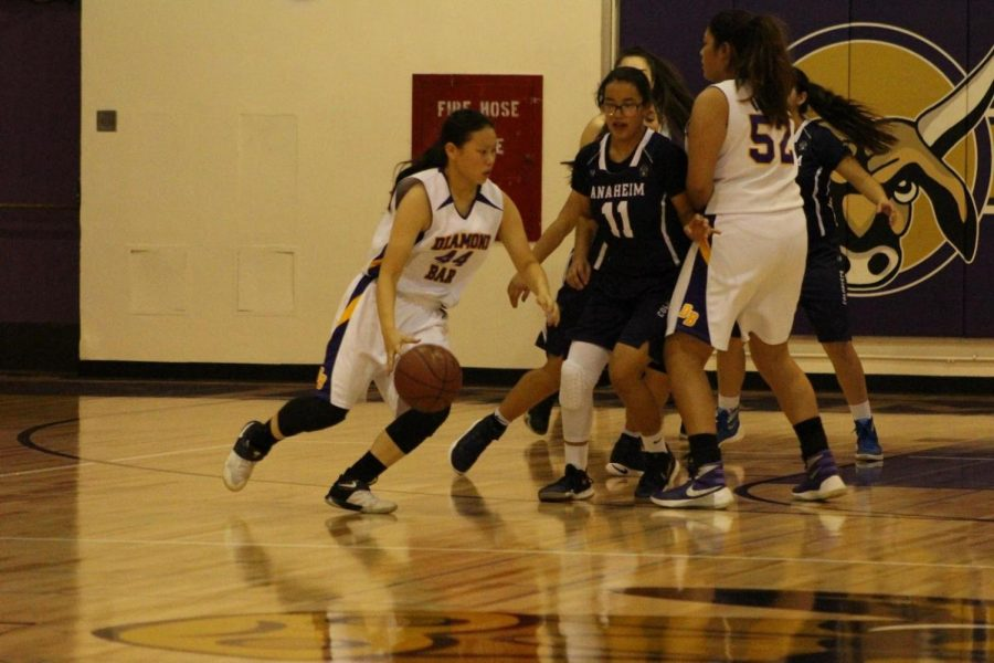 Senior Jessica Barrera (52) sets up junior Angela Hung (44) on a pick and roll.