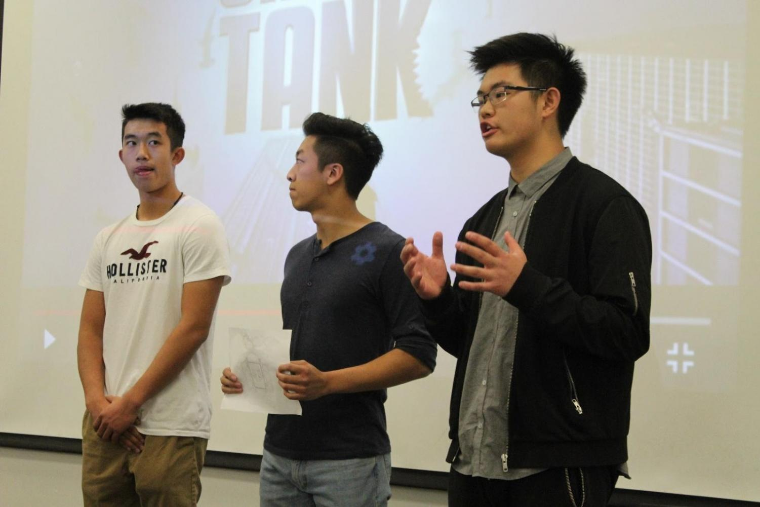 From left to right, seniors Ryan Trinh, Kilik Ov and Jacky Chen present their product, called Click, to a panel of judges.