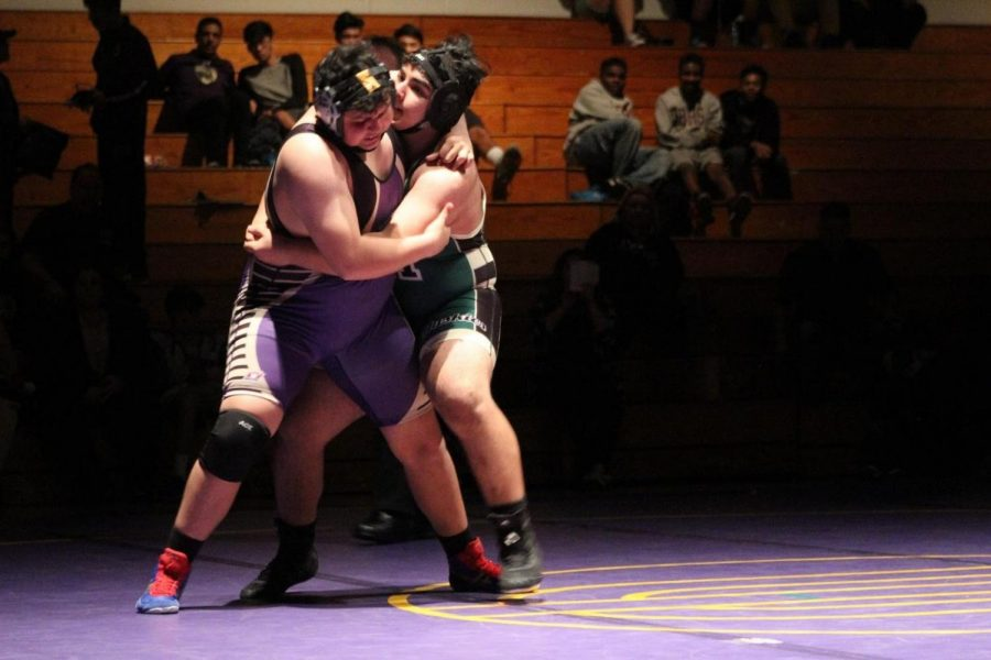 Senior heavyweight Daniel Perez competes in a match against South Hills.