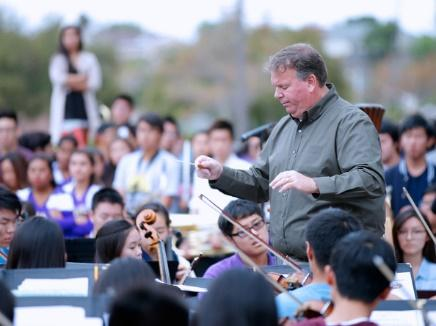 Steve Acciani led the DBHS Symphony Orchestra in 2014 during the Ford Drive 4UR School Event, when the music program was named the National Grammy Signature School in 2016.