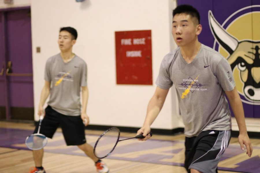 Seniors Brian Ng, left, and Kevin Nea practice as a doubles team.