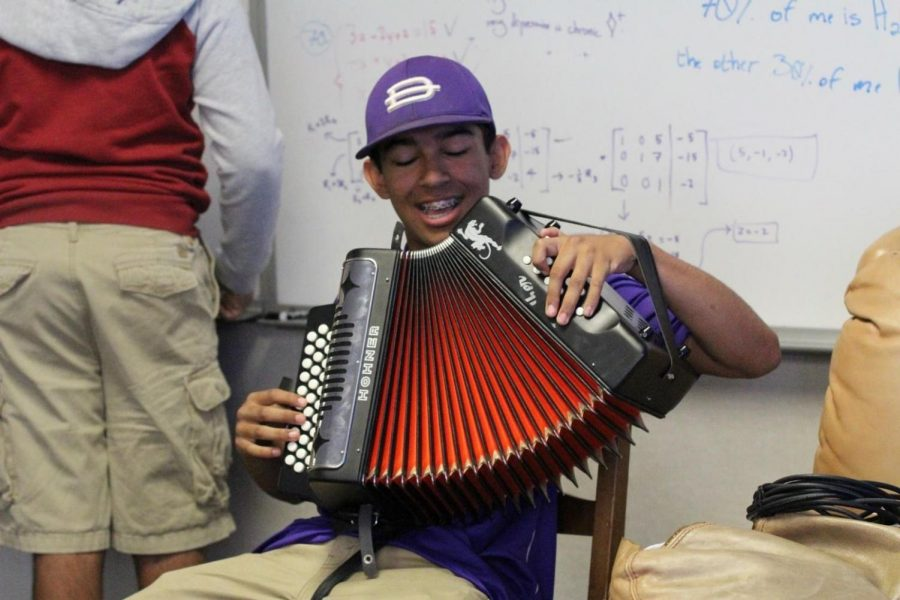 Dominic Correa shows off his accordion skills during commercial music class