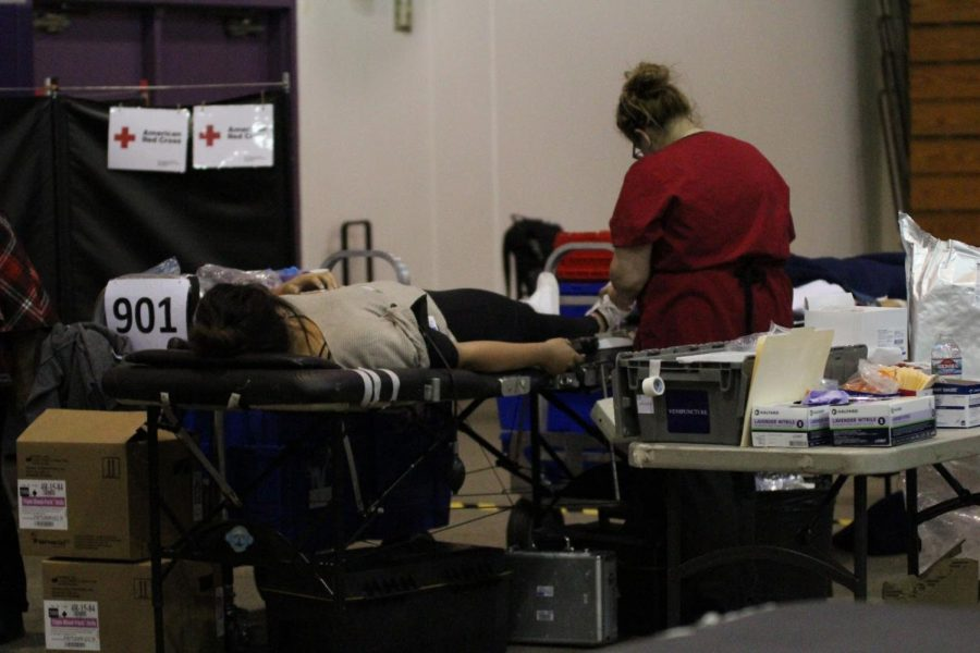 A DBHS student lays on a gurney while a Red Cross nurse prepares to withdraw blood for the April 16 donation drive.