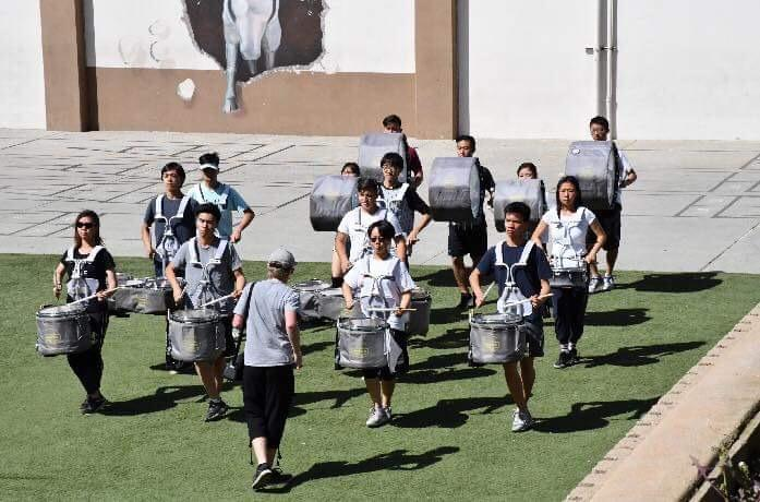 World Line, the varsity drumline, rehearses for their final competition in the ampitheatre