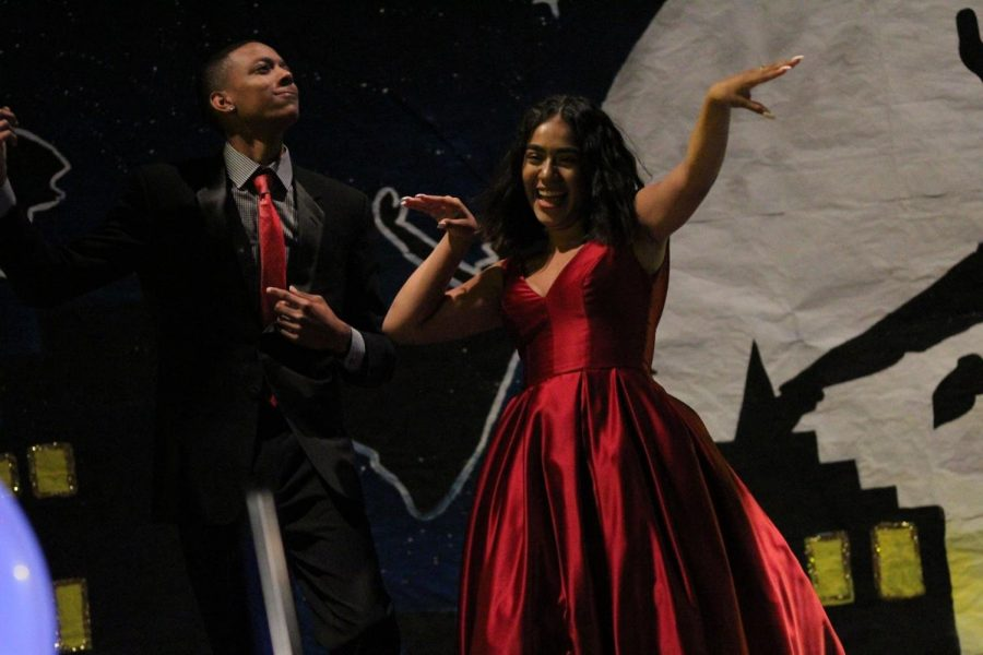 DBHS seniors Angela Kieta and Connor Magpayo walk down the catwalk at Prom Fashion Show in the gym on April 13.