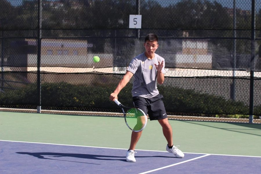 Senior Nicholas Wong rallies back and forth in a 14-4 win against Glendora.