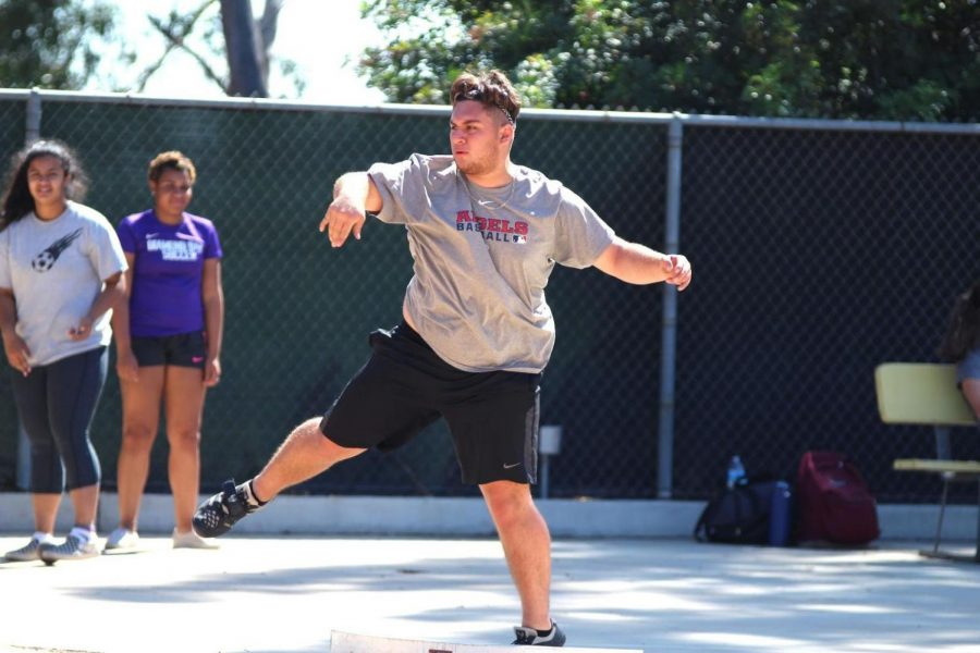 Senior Ryan Vargas practices his shotput in preparation for their final meet.